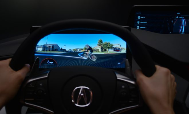 An advanced vision mode leverages sensors and artificial intelligence to display cars, pedestrians, bicyclists and other objects – even those obscured from vision – using artificial intelligence to predict future pathways. This mode builds human confidence in the car's automated driving systems.